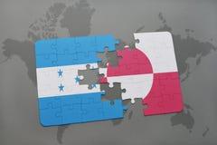 困惑与洪都拉斯和格陵兰的国旗世界地图背景的 免版税库存照片