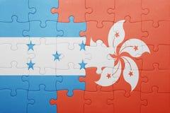 困惑与洪都拉斯和香港国旗  库存照片
