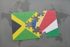 困惑与牙买加和塞舌尔群岛的国旗世界地图的 库存图片