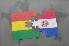 困惑与玻利维亚和巴拉圭的国旗世界地图背景的 库存照片