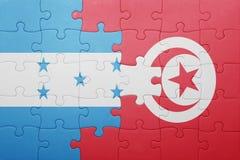 困惑与突尼斯和洪都拉斯的国旗 免版税库存照片