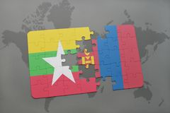 困惑与缅甸和蒙古的国旗世界地图背景的 库存照片