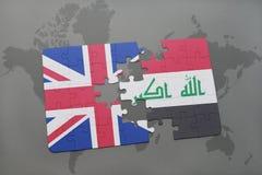 困惑与英国和伊拉克的国旗世界地图背景的 免版税库存图片