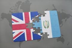 困惑与英国和危地马拉的国旗世界地图背景的 库存照片