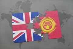 困惑与英国和吉尔吉斯斯坦的国旗世界地图背景的 库存照片