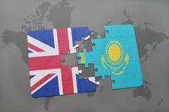 困惑与英国和哈萨克斯坦国旗世界地图背景的 免版税库存照片