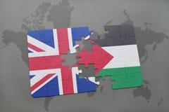 困惑与英国和巴勒斯坦的国旗世界地图背景的 免版税库存照片