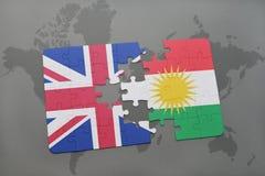 困惑与英国和库尔德斯坦的国旗世界地图背景的 库存照片