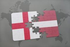 困惑与英国和拉脱维亚的国旗世界地图背景的 免版税库存图片