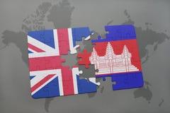 困惑与英国和柬埔寨的国旗世界地图背景的 免版税库存照片
