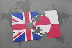 困惑与英国和格陵兰的国旗世界地图背景的 免版税库存图片