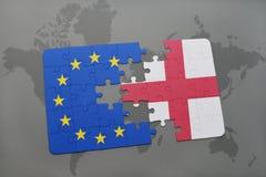 困惑与英国和欧盟国旗在世界地图 免版税图库摄影