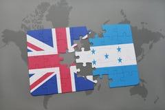 困惑与英国和洪都拉斯的国旗世界地图背景的 库存照片
