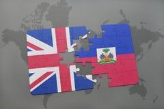困惑与英国和海地的国旗世界地图背景的 库存图片