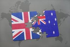 困惑与英国和澳大利亚的国旗世界地图背景的 库存图片