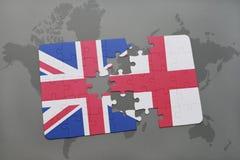 困惑与英国和英国的国旗世界地图背景的 库存图片
