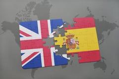 困惑与英国和西班牙的国旗世界地图背景的 库存图片