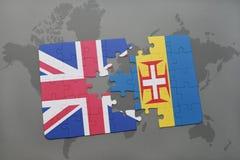 困惑与英国和马德拉岛的国旗世界地图背景的 库存图片