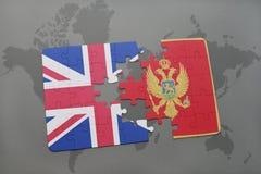 困惑与英国和黑山的国旗世界地图背景的 免版税库存照片