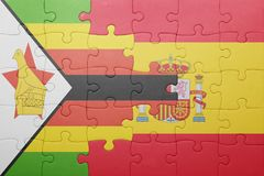 困惑与西班牙和津巴布韦的国旗 免版税库存图片