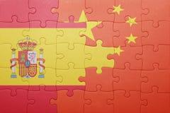 困惑与西班牙和瓷国旗  库存图片