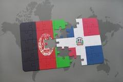 困惑与阿富汗和多米尼加共和国的国旗世界地图背景的 免版税库存图片
