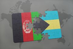 困惑与阿富汗和巴哈马的国旗世界地图背景的 库存图片