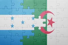 困惑与阿尔及利亚和洪都拉斯的国旗 库存图片