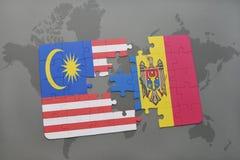 困惑与马来西亚和摩尔多瓦国旗世界地图背景的 免版税库存照片
