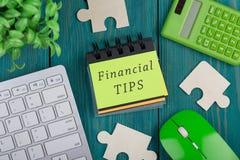 困惑片断、计算器、笔记本有文本的& x22; 财政tips& x22; 键盘 免版税库存照片