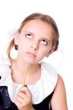 困惑的女小学生 库存图片