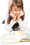困惑的女小学生 免版税库存照片