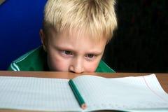 困难的学校家庭作业 免版税库存图片