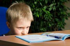 困难的学校家庭作业 库存照片
