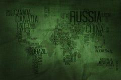 国名印刷术在军事织品纹理B的世界地图 免版税库存照片