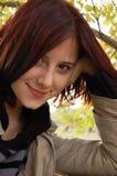国家(地区)女孩微笑的查阅 库存图片