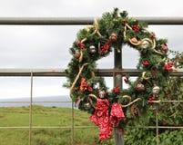 国家(地区)牛仔圣诞节花圈 免版税图库摄影
