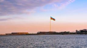 国旗正方形在日落的巴库 免版税库存照片