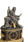 国王古色古香的法国壁炉台时钟和小雕象  库存照片