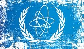国际原子能机构的旗子 起皱纹的肮脏的斑点 向量例证