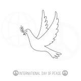 国际天与白色鸠的和平横幅 免版税库存照片