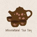 国际茶天 在抽象背景的茶具 手d 免版税库存照片