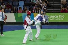 国际跆拳道比赛在里约- JPN对CHN 图库摄影