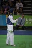 国际跆拳道比赛在里约- JPN对CHN 免版税库存图片