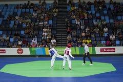 国际跆拳道比赛在里约- JPN对CHN 库存照片