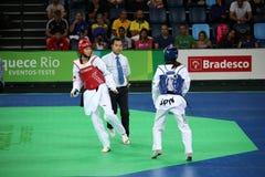 国际跆拳道比赛在里约- JPN对CHN 免版税图库摄影
