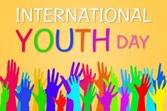 国际青年天横幅图形设计的五颜六色的手 图库摄影