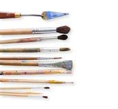 绘图工具,套在行的肮脏的画笔 免版税库存照片