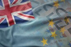 图瓦卢的五颜六色的挥动的国旗欧元金钱钞票背景的 库存照片