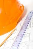 图纸盔甲橙色铅笔统治者 图库摄影